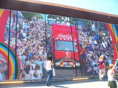 Coke, at the exit of the Olympic Mall on the way to the stadium.