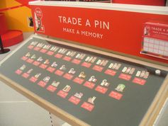 Coke is trying to create demand for their Olympic Pins by linking the product to the experience.