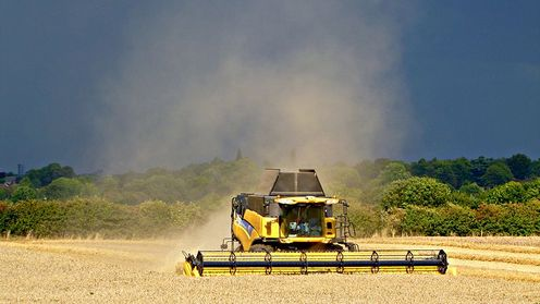 File_new_holland_combine_at_work_near_stoneleigh_1